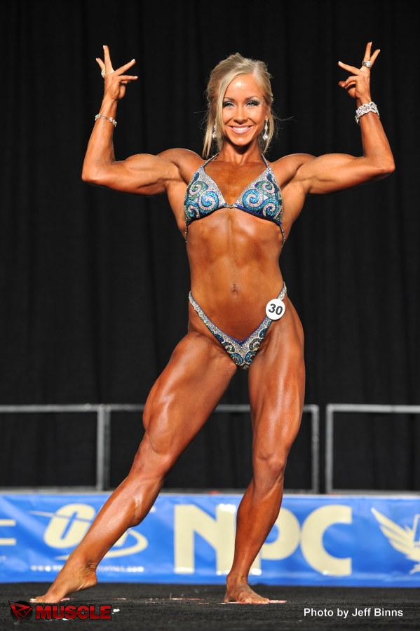 Pretty blonde female fitness competitor Michelle Davis flexing onstage ...: www.reddit.com/r/Celebs/related/1m5bvn/michelle_jennekes_infectious...